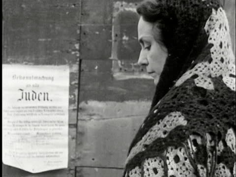 ms, b/w, woman reading poster on wall, usa - judaism stock-videos und b-roll-filmmaterial
