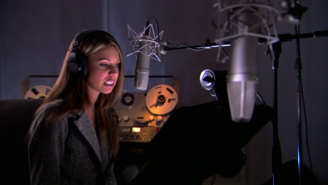 woman reading script in recording studio - see other clips from this shoot 1429 stock videos & royalty-free footage