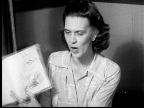 1945 FILM MONTAGE MS Woman reading to classroom of young children/ MS teacher holding up book with illustration of pig/ MS reaction shot of children laughing/ Sylacauga, Alabama
