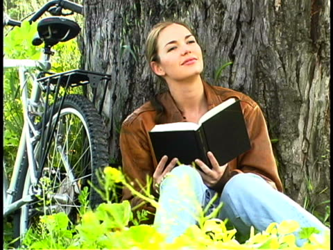woman reading - three quarter length stock videos & royalty-free footage