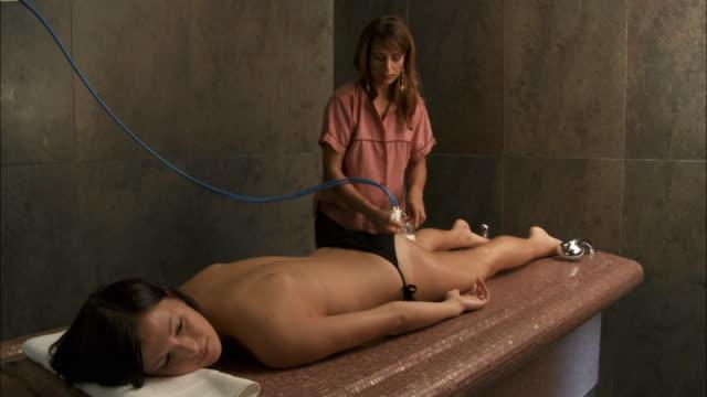 WS Woman receiving anti-cellulite treatment / Brussels, Belgium