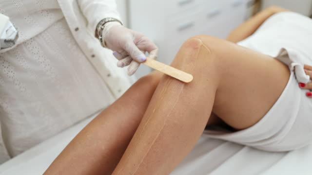 woman receiving epilation treatment - beauty salon stock videos & royalty-free footage