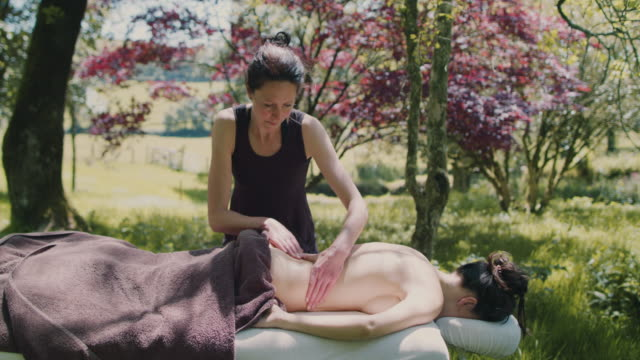 Woman receiving massage outside