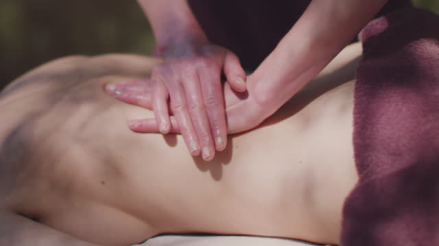 woman receiving massage outside - massage table stock videos and b-roll footage