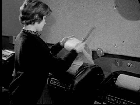 1955 film montage ms woman receiving news feed from united press teleprinter/ cu woman reading tearing paper/ ms woman and printer/ buffalo, new york - 1955 stock-videos und b-roll-filmmaterial