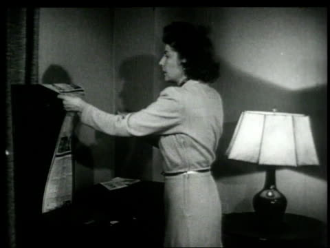 1948 montage woman receiving newspaper in her living room from a facsimile broadcasting machine / united states - fax machine stock videos & royalty-free footage