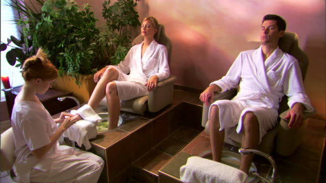 woman receiving pedicure at a spa - pedicure stock videos & royalty-free footage