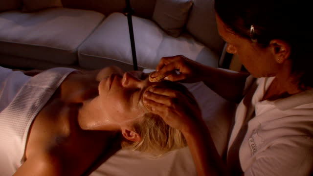 ms woman receiving spa treatmernt / bagni di lucca, tuscany, italy - beauty spa stock videos & royalty-free footage