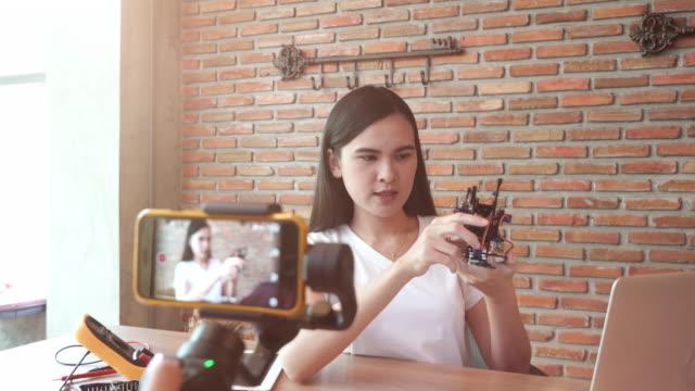 Woman recording video for DIY stuff preparation