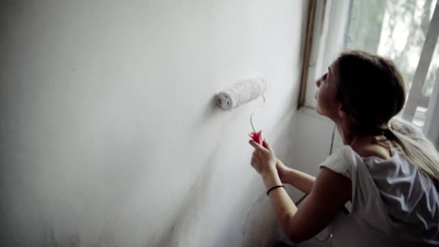 woman redecorating a place to live - bricolage video stock e b–roll