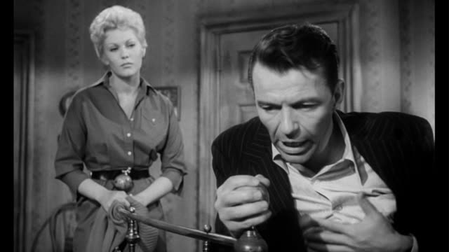 1955 woman (kim novak) refuses when man (frank sinatra) begs for money to buy a hit - pleading stock videos & royalty-free footage
