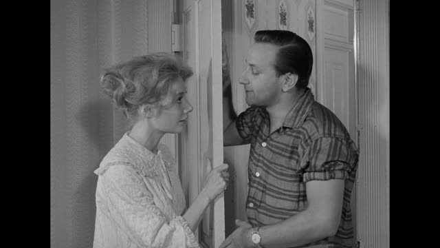 vídeos de stock, filmes e b-roll de 1962 a woman rejects advances from peeping man - espreitando