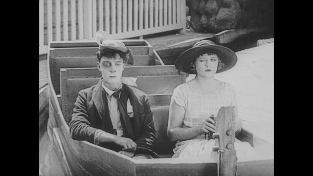 1923 woman (phyllis haver) rejects man's (buster keaton) tunnel of love advances - ticket stock videos & royalty-free footage
