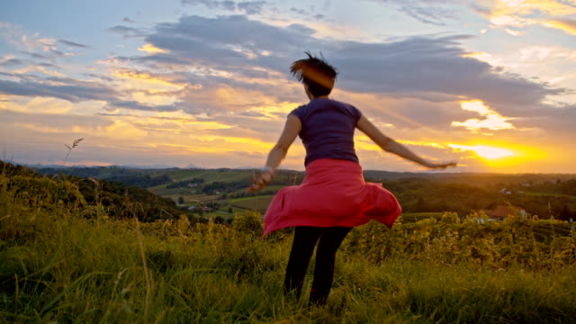slo mo woman rejoicing in nature - ecstatic stock videos and b-roll footage