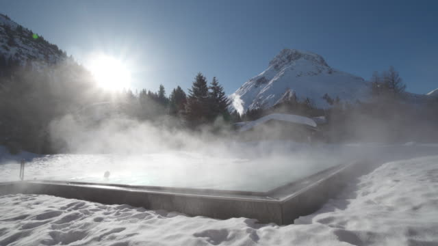 a woman relaxes in a hot tub hot tub at a spa. - hot tub stock videos & royalty-free footage