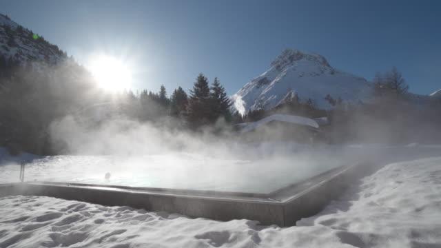 vídeos de stock, filmes e b-roll de a woman relaxes in a hot tub hot tub at a spa. - banho terapêutico