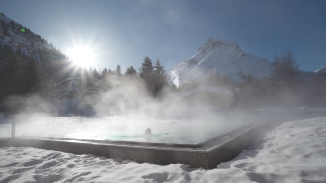 a woman relaxes in a hot tub hot tub at a spa. - spa video stock e b–roll