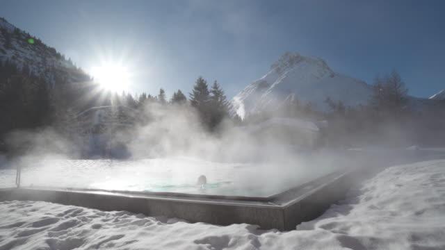 vídeos y material grabado en eventos de stock de a woman relaxes in a hot tub hot tub at a spa. - spa