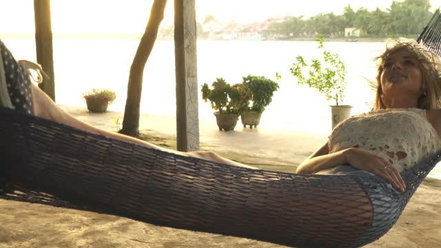 Woman relaxes in hammock