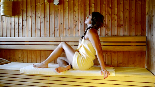 woman relaxes in sauna and enjoys spa treatment - sauna stock videos and b-roll footage