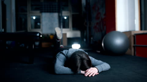 woman relaxing after training in gym - looking away video stock e b–roll