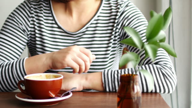 Woman relaxing at coffee cafe with hot coffee , relaxation concept
