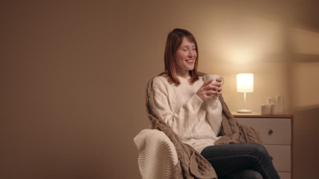 woman relaxing at home drinking a cup of coffee - mug stock videos and b-roll footage