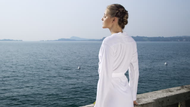 woman relaxing at lake - bathrobe stock videos & royalty-free footage