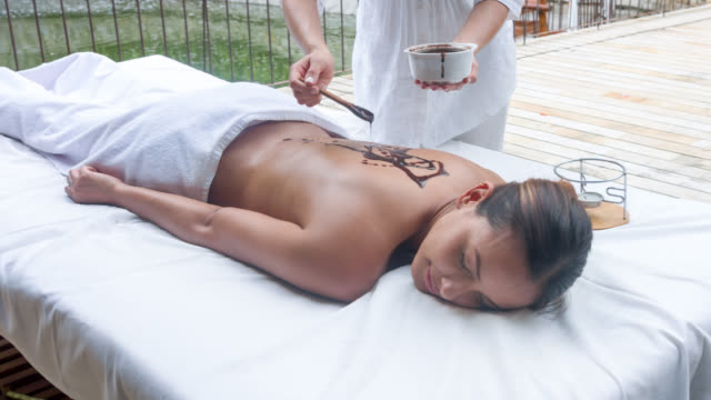 woman relaxing at the spa - exfoliation stock videos & royalty-free footage