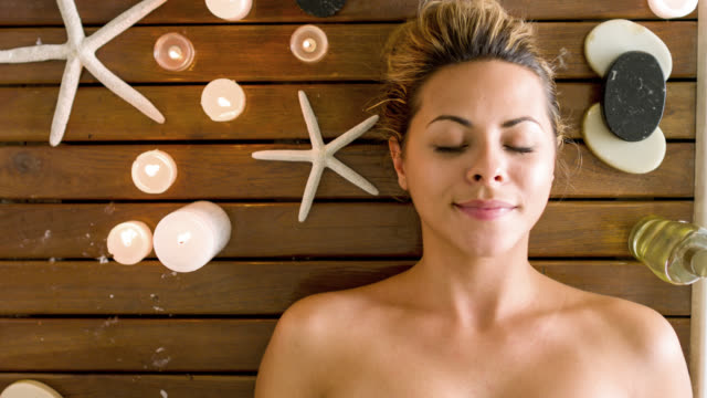 woman relaxing at the spa - spa treatment stock videos & royalty-free footage