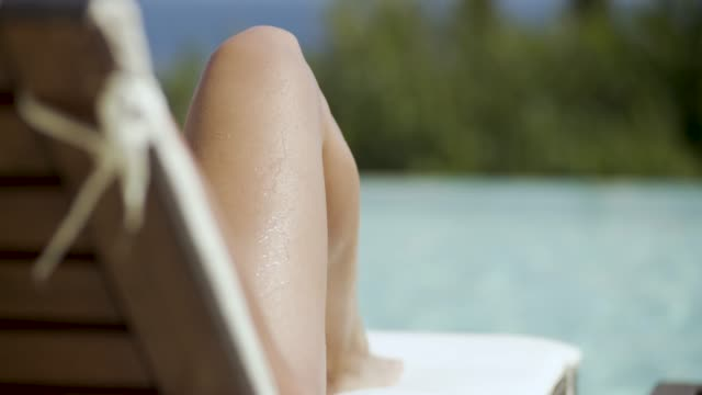 woman relaxing by the pool on corfu, greece - sunbed stock videos & royalty-free footage
