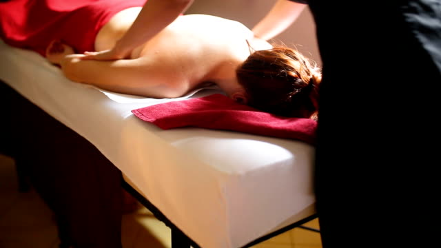 woman relaxing during massage at the spa - health resort stock videos & royalty-free footage