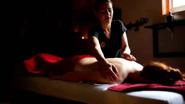 Woman relaxing during massage at the spa