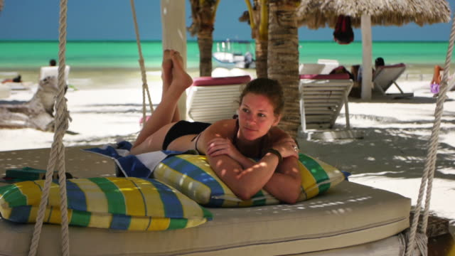 woman relaxing in a hammock - quintana roo stock videos and b-roll footage