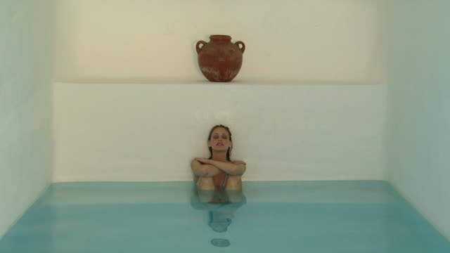 A woman relaxing in an indoor pool