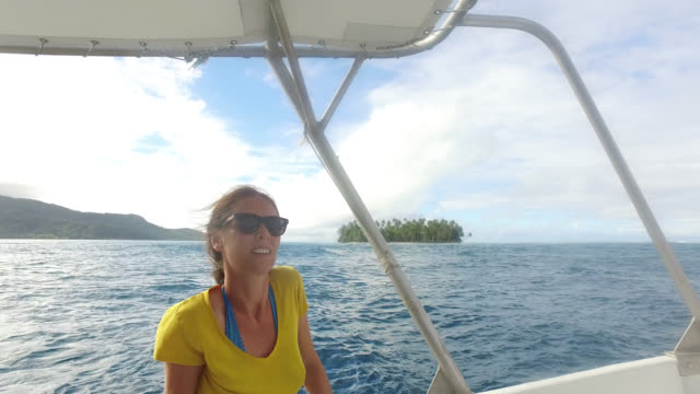 woman relaxing in boat on water - tahaa island stock videos & royalty-free footage