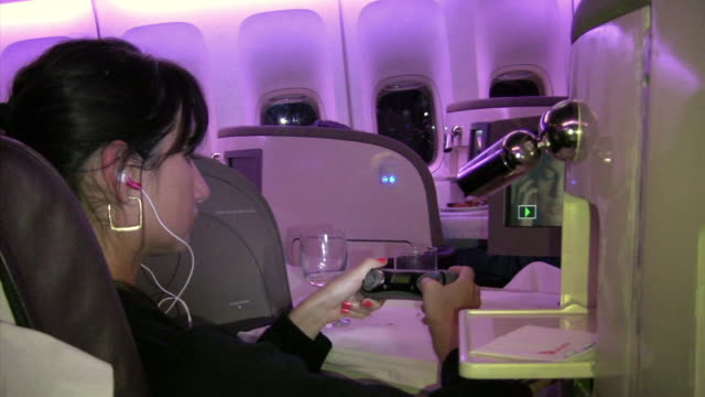 cu, woman relaxing in first class of plane - vehicle interior stock videos & royalty-free footage
