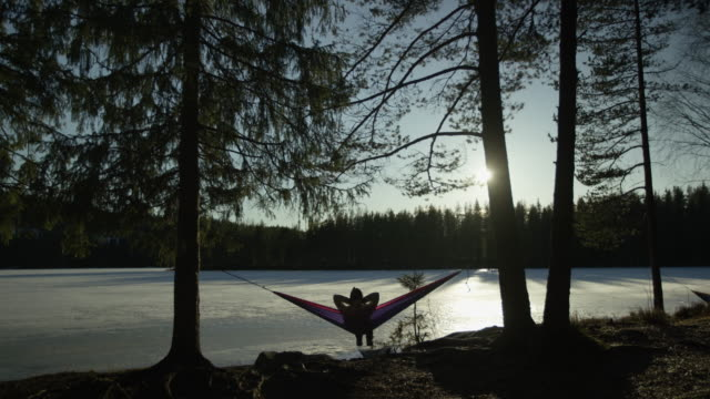 woman relaxing in hammock at lake - hammock stock videos & royalty-free footage