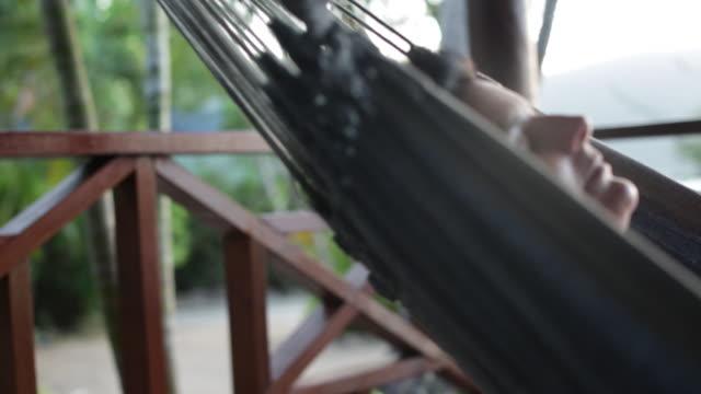 CU Woman relaxing in hammock.