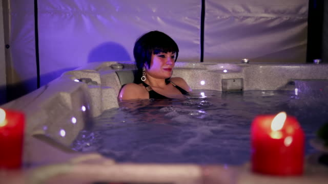 woman relaxing in jaccuzi - hot tub stock videos and b-roll footage