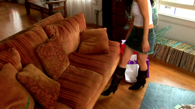 woman relaxing in living room - stiefel stock-videos und b-roll-filmmaterial