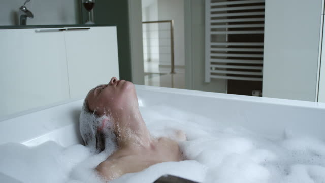 woman relaxing in modern bathtub - taking a bath stock videos & royalty-free footage