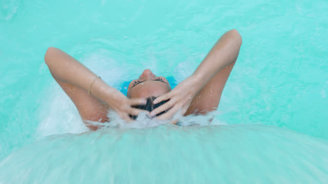woman relaxing in the swimming pool - massage stock videos & royalty-free footage