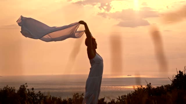slo mo woman relaxing in warm summer breeze - shawl stock videos and b-roll footage