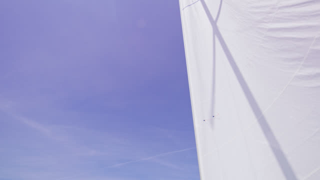 td woman relaxing on a deck of a sailboat - sail stock videos & royalty-free footage
