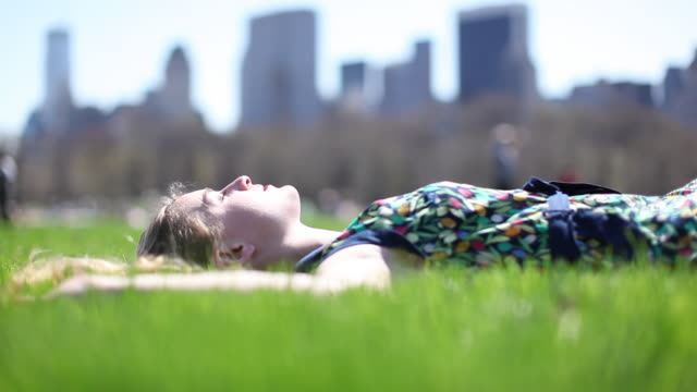 MS Woman relaxing on central park / New York City, New York, United States