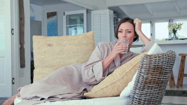 woman relaxing on patio - bathrobe stock videos & royalty-free footage