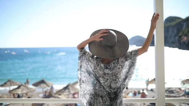 woman relaxing on vacation - cappello video stock e b–roll
