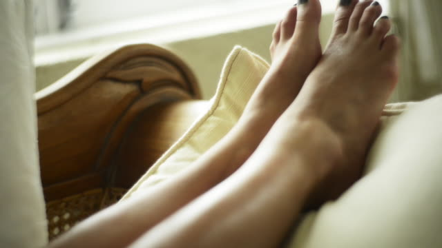 woman relaxing - low section stock videos & royalty-free footage