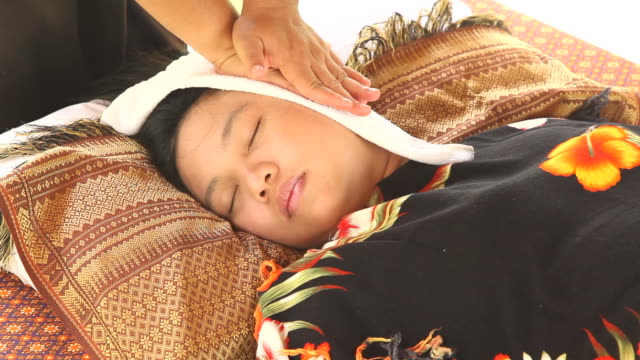 woman relaxing while getting massage - massage oil videos stock videos and b-roll footage